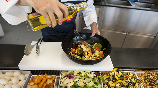 Sodexo chef preparing a salad