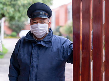 Security guard wearing a face mask