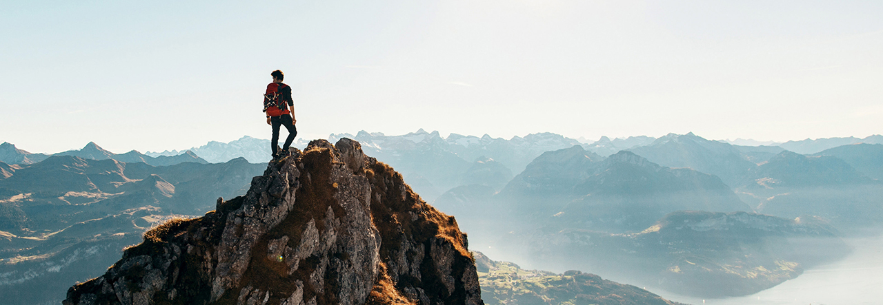Person hiking at the top of a mountain