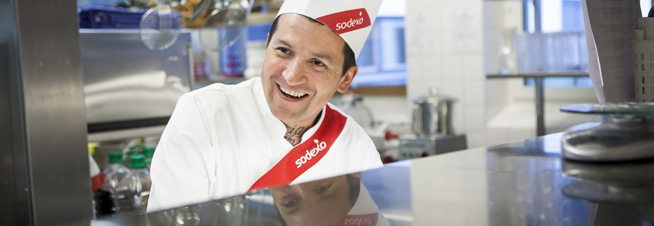 Sodexo chef smiling in a kitchen