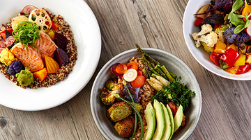 Three beautiful, healthy grain bowls filled with colorful vegetables and lean proteins