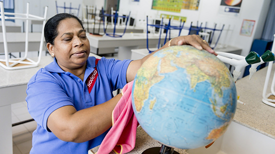 Sodexo employee cleaning a globe