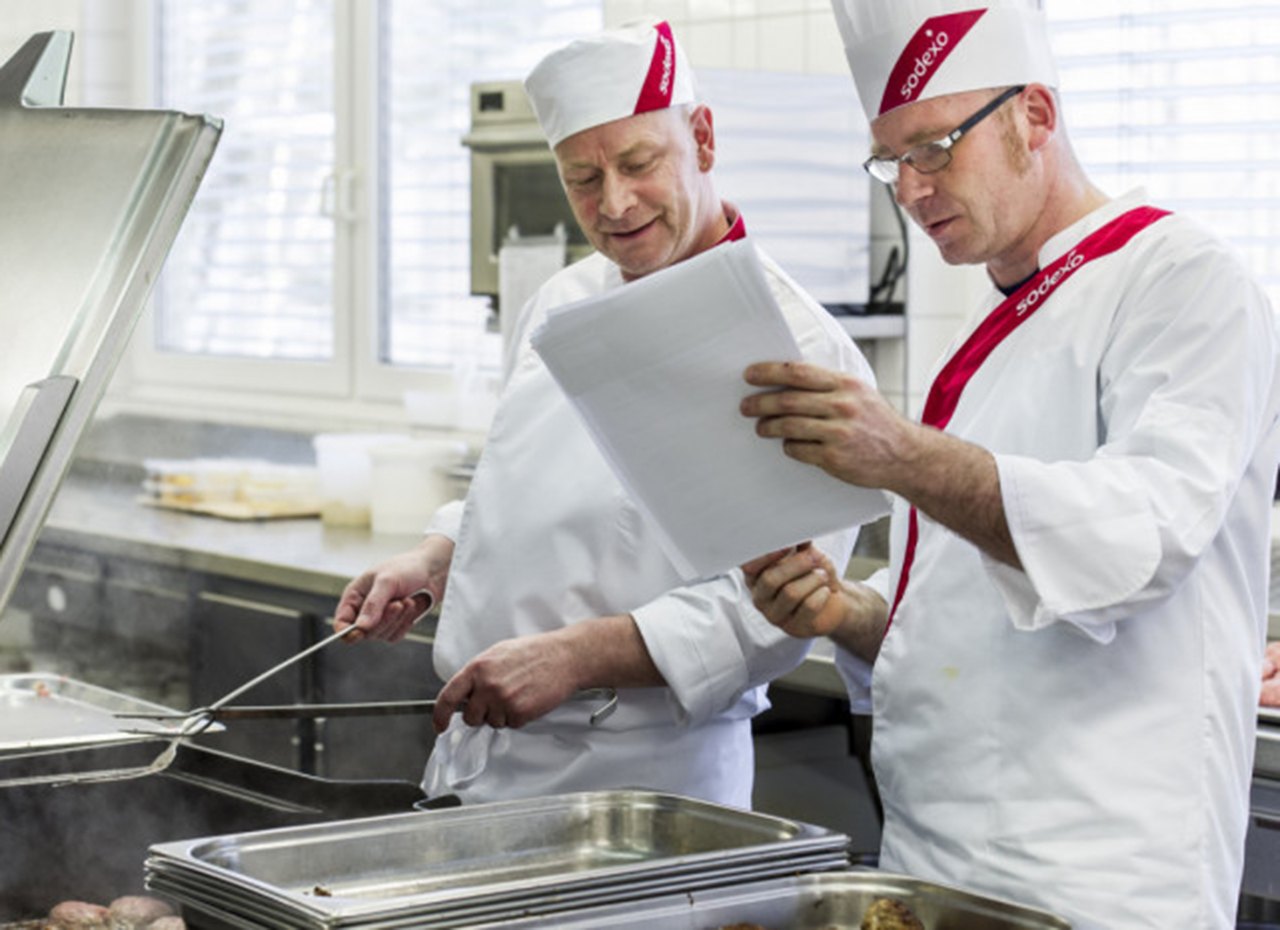 Two Sodexo chefs checking notes