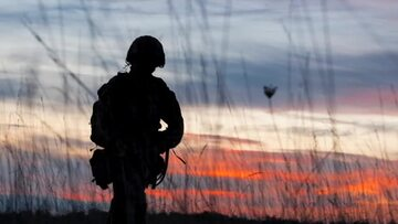 Soldier silhoutte against a sunset background