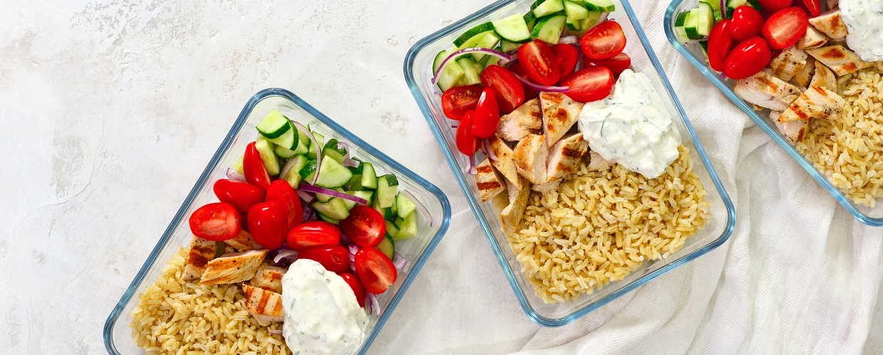 Take away rice chicken and salad in a glass box