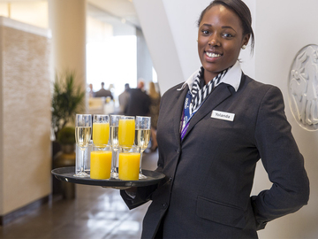 Sodexo air lounge employee serving beverages
