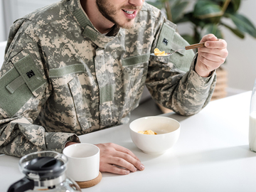 Soldier eating a bowl of cereal