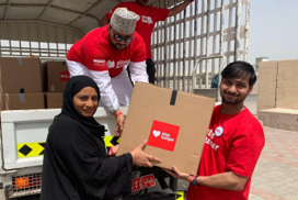 Man and woman delivring Stop Hunger boxes